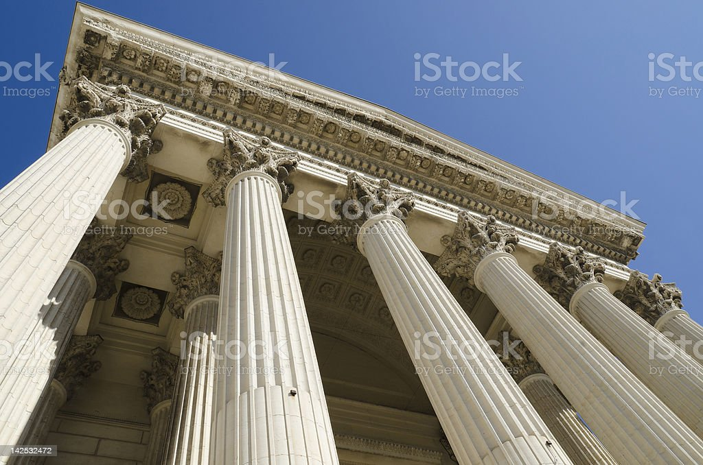 A ground view of columns on a building stock photo