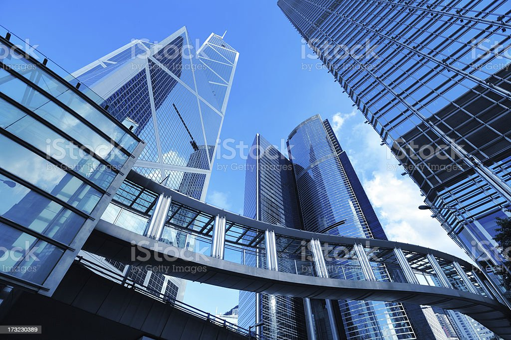 Ground view of high rise metal buildings stock photo