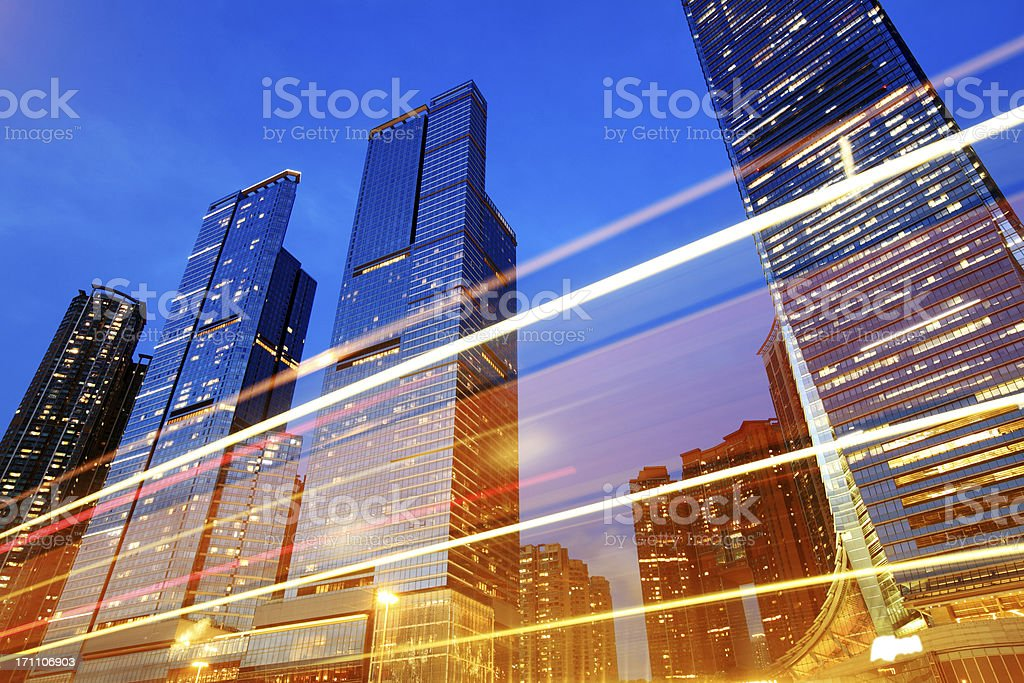 Ground view of tall buildings at night stock photo