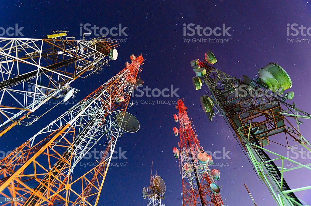 Ground view of telecommunication towers stock photo
