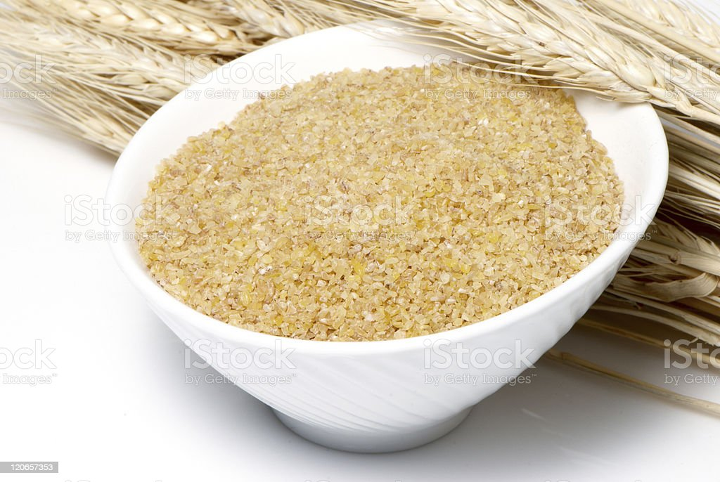Ground wheat and ears on a light background royalty-free stock photo