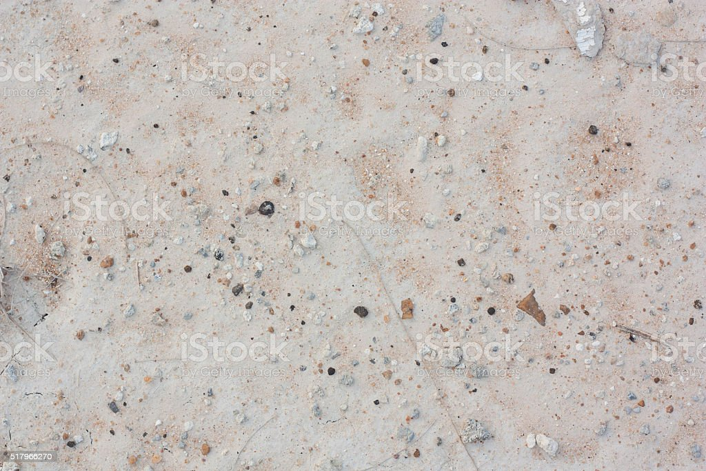 Ground white, filled with gravel and sand. stock photo