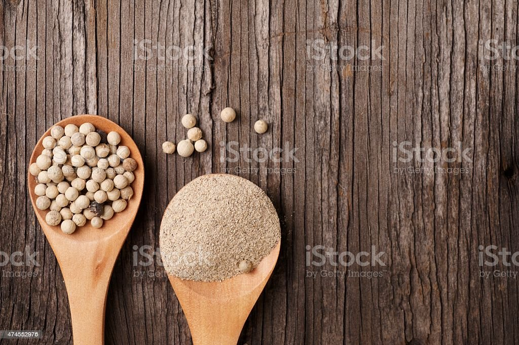 Ground white pepper and peppercorn stock photo