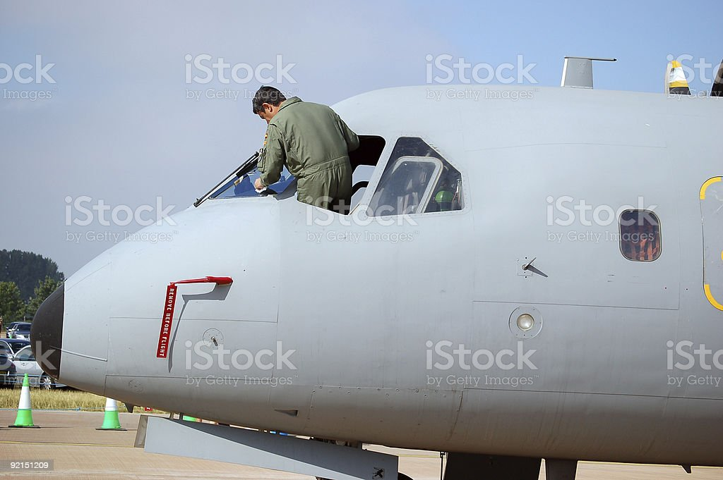 Grounded aircraft being cleaned stock photo