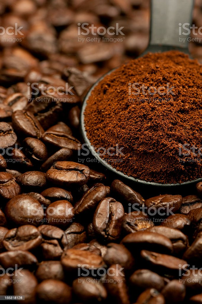 Grounded coffee powder and beans stock photo