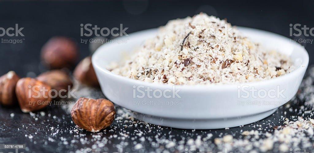 Grounded Hazelnuts on a slate slab stock photo