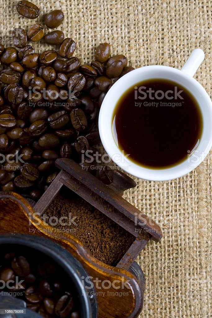 Grounds and coffee grinder royalty-free stock photo