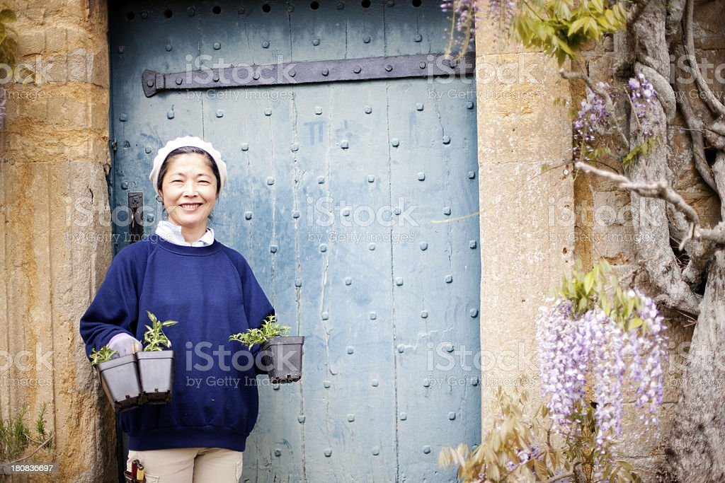 Groundswoman by country house doorway stock photo
