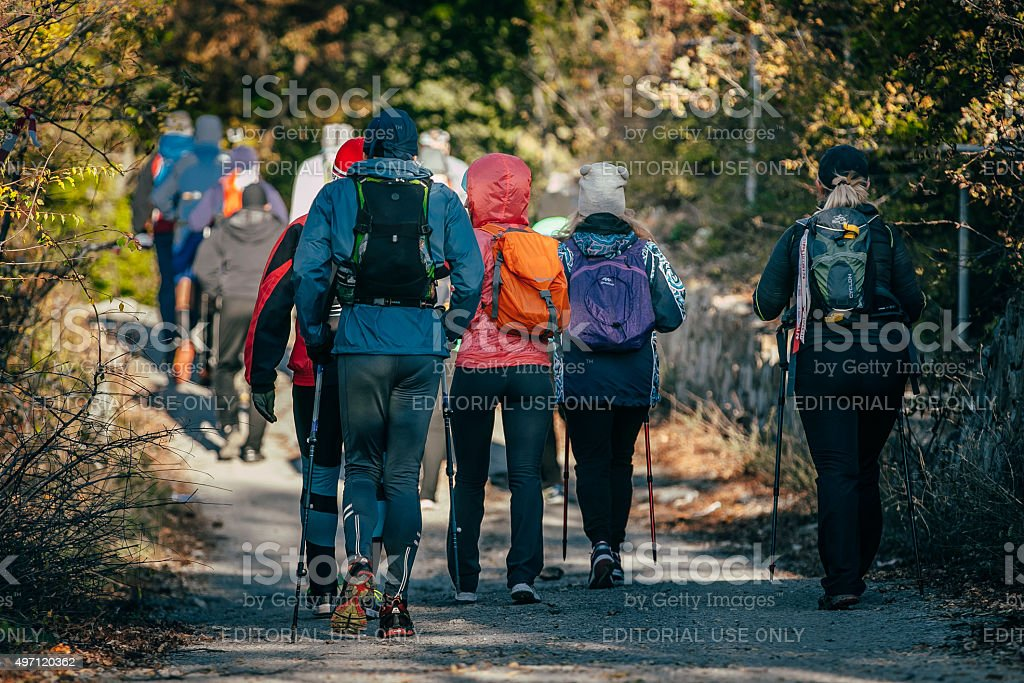 group athlete with sticks to walk started stock photo