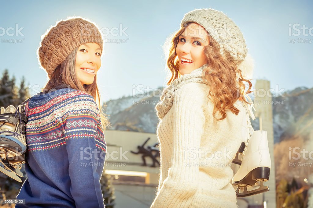 Group beautiful teenager girls ice skating outdoor at ice rink stock photo
