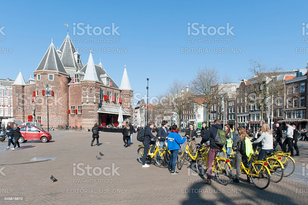 Group bike renters in front of weigh house in Amsterdam stock photo