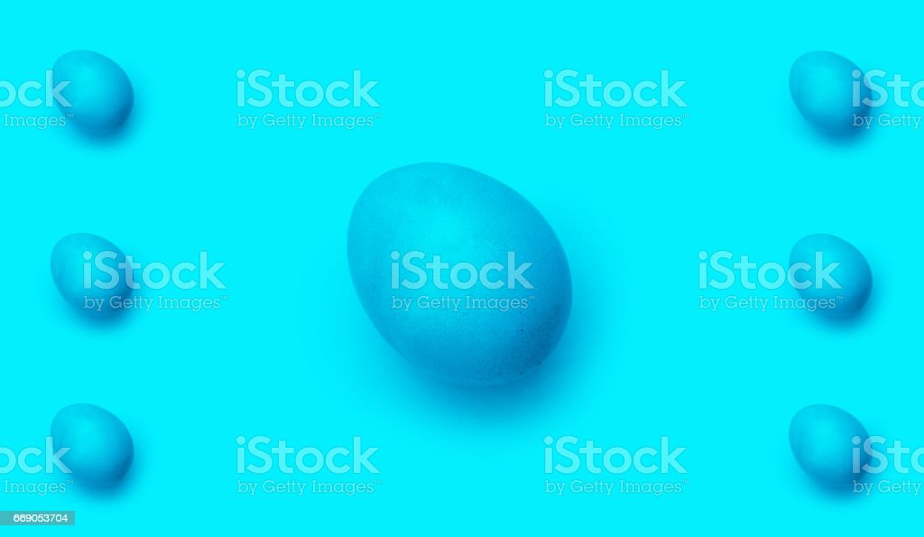 group blue easter egg, isolated on blue background. stock photo