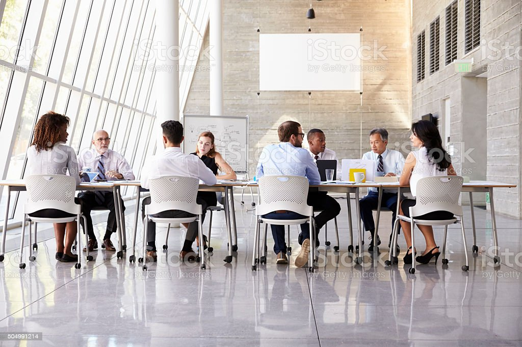Group Business Meeting Around Table In Modern Office stock photo