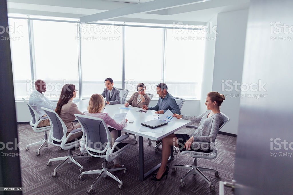 Group business meeting in office conference room stock photo