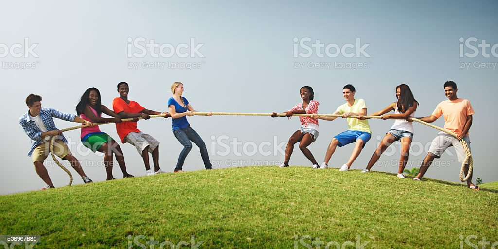 Group Casual People Playing Tug War Concept stock photo