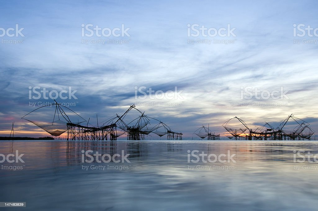 Group catching fish with fishnet on the Mekong talanoi stock photo