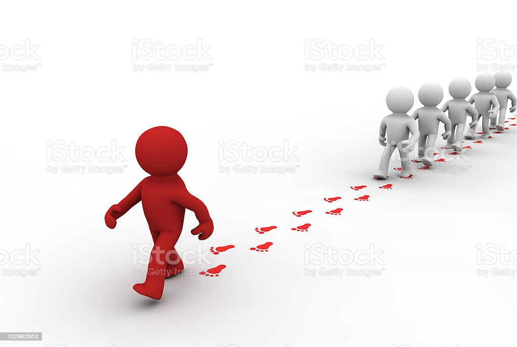 group following the footprints of leader stock photo