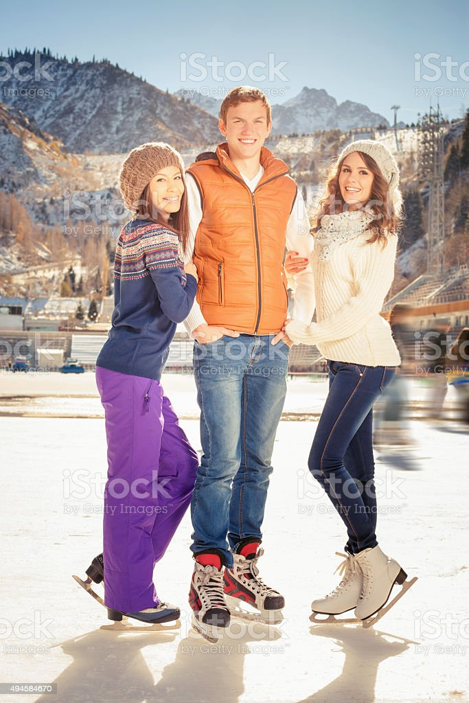 Group funny people ice skating outdoor at ice rink stock photo