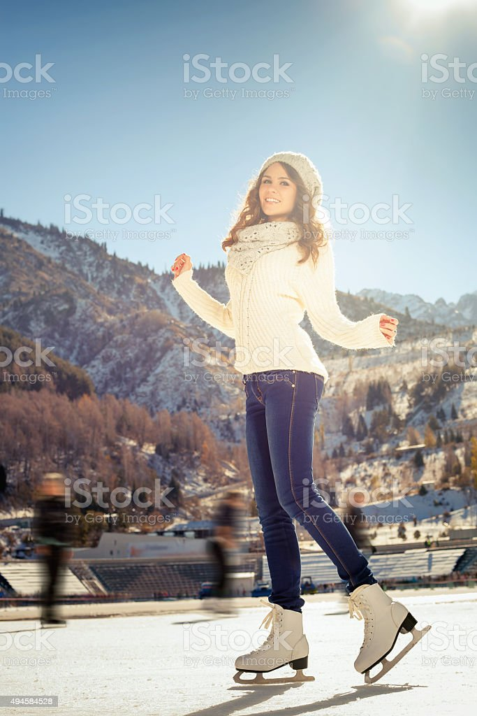 Group funny teenagers girls ice skating outdoor at ice rink stock photo