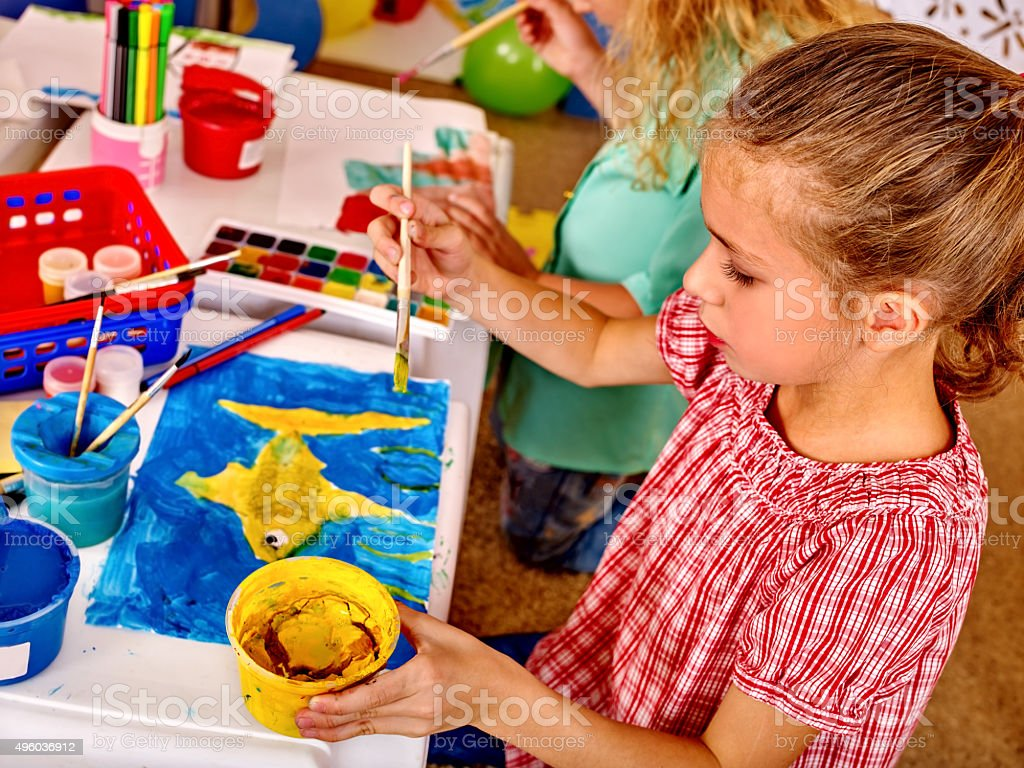 Group girl with brush painting in  kindergarten stock photo