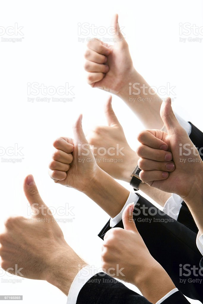 A group gives unanimous approval through a thumbs up royalty-free stock photo