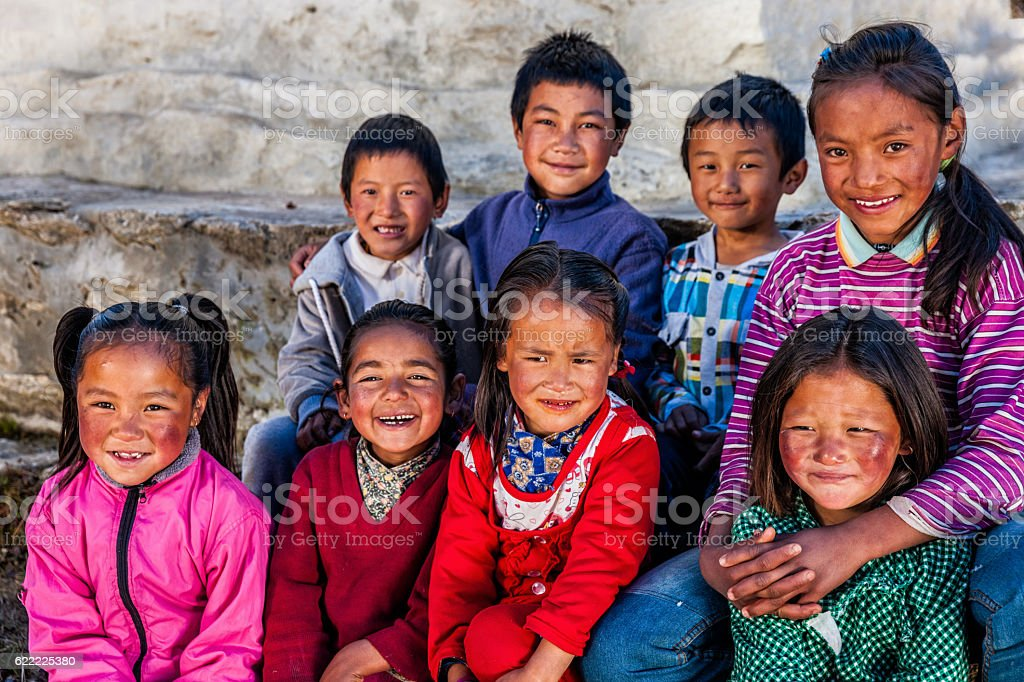 Group happy Sherpa children in Everest Region stock photo