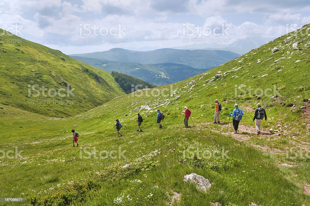 Group Hiking In Mountians royalty-free stock photo