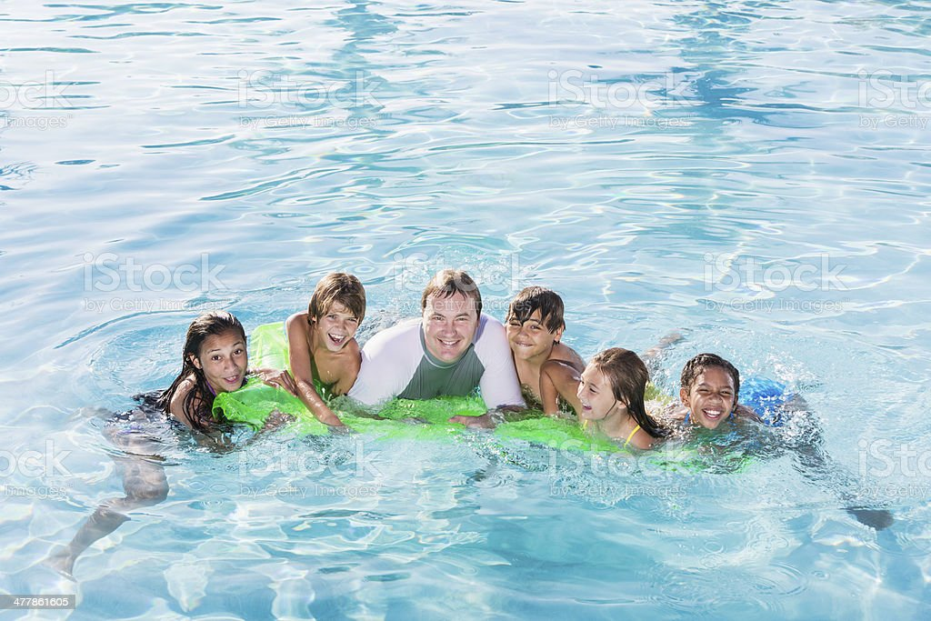 Group in swimming pool royalty-free stock photo