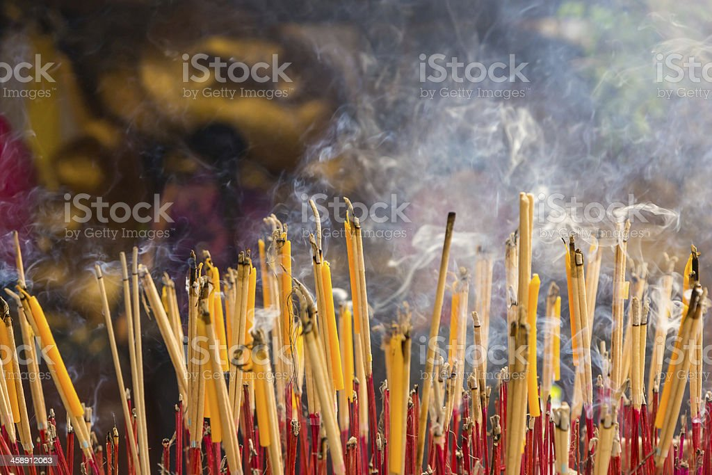 Group incense with candle and statue in horizontal background royalty-free stock photo