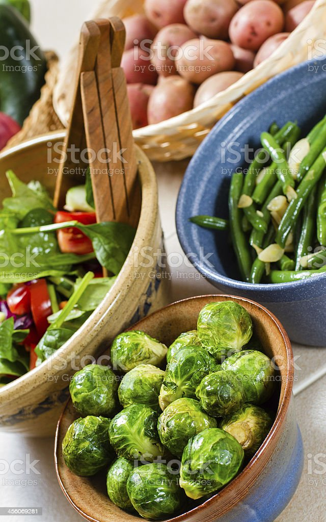 Group including a salad, brussels sprout, green beans & potatoes. royalty-free stock photo