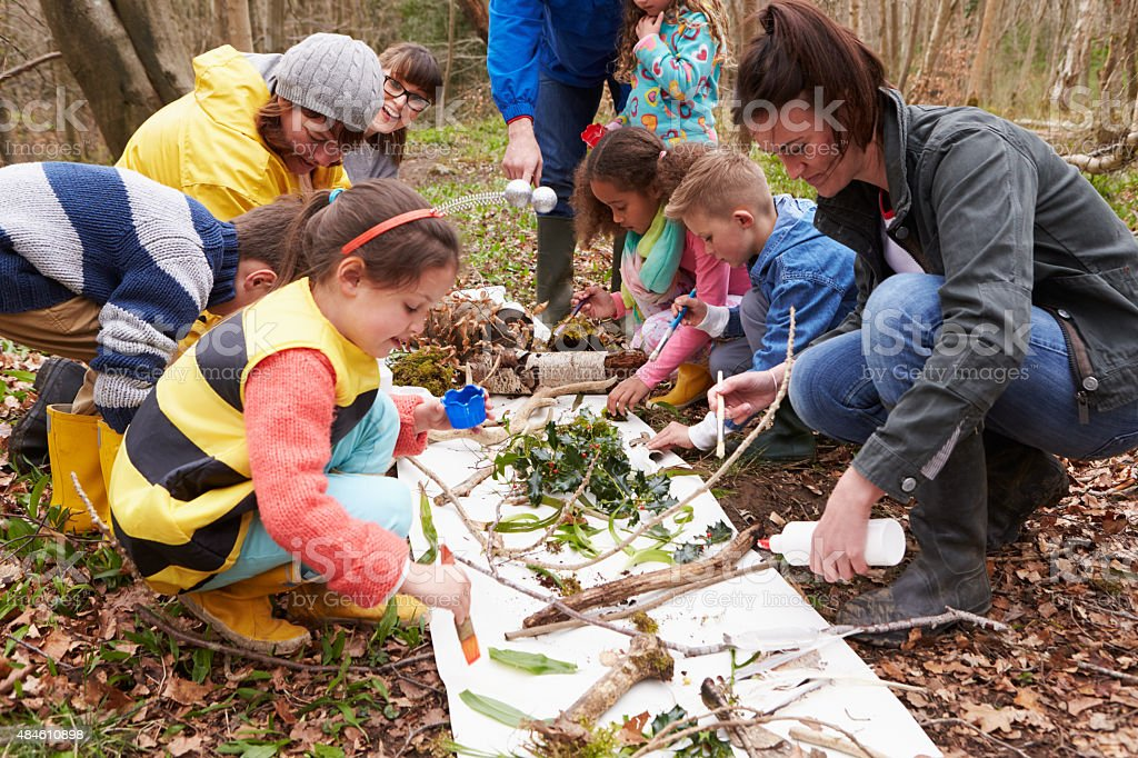 Group Looking For Minibeasts At Activity Centre stock photo