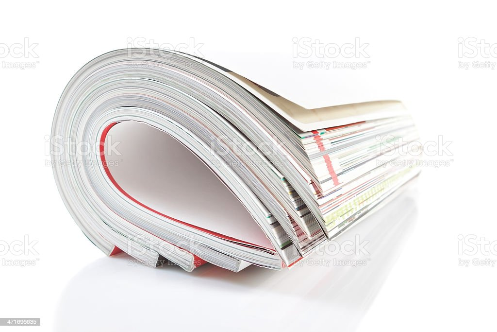 Group monthly magazine. Close-up on a white background. royalty-free stock photo