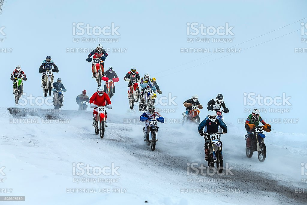 group motorcycle racer going on snowy mountain stock photo