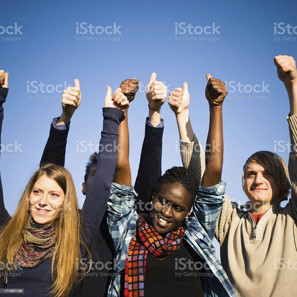 Group multiracial friends showing thumbs-up royalty-free stock photo