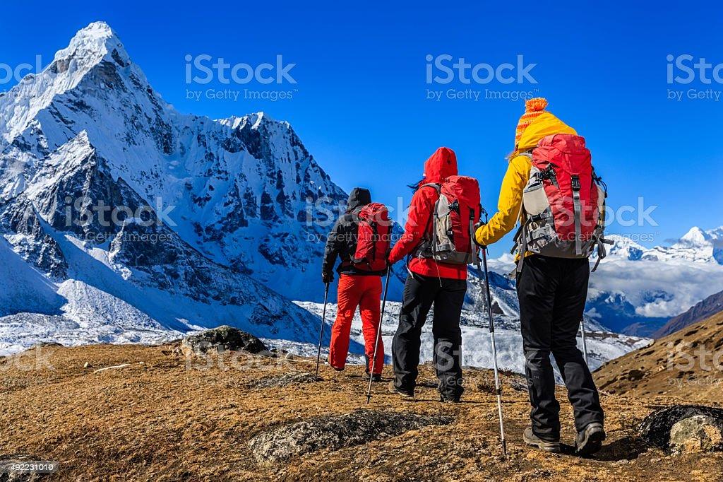Group of 3 trekkers in Mount Everest National Park, Nepal stock photo