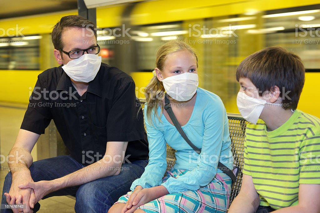 Group of 3 with masks on because of swine flu panic stock photo