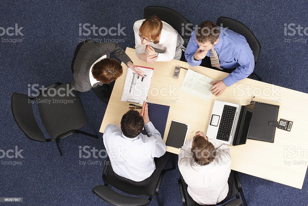 Group of 4 business people discussing a presentation royalty-free stock photo