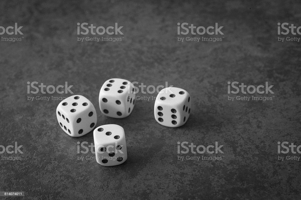 group of 4 white dice on grey background stock photo