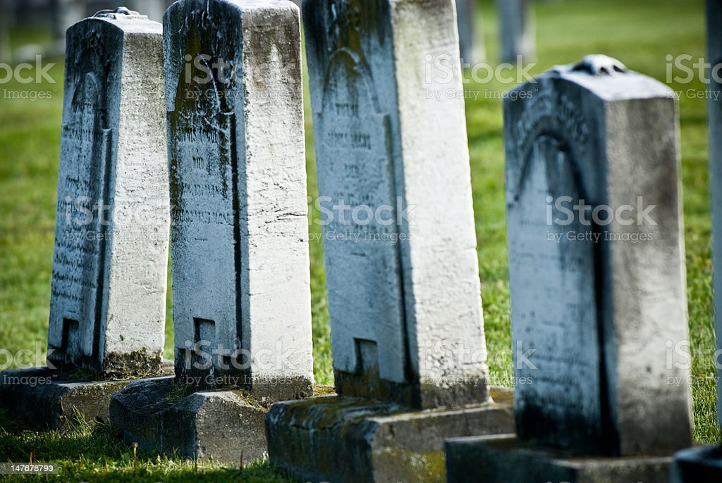 Group of 4 White Tombstones in a row stock photo