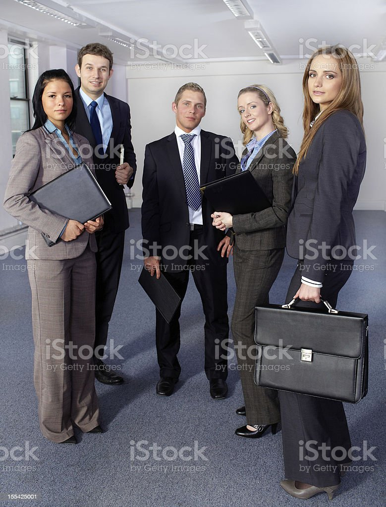 Group of 5 business people, standing and looking to camera royalty-free stock photo