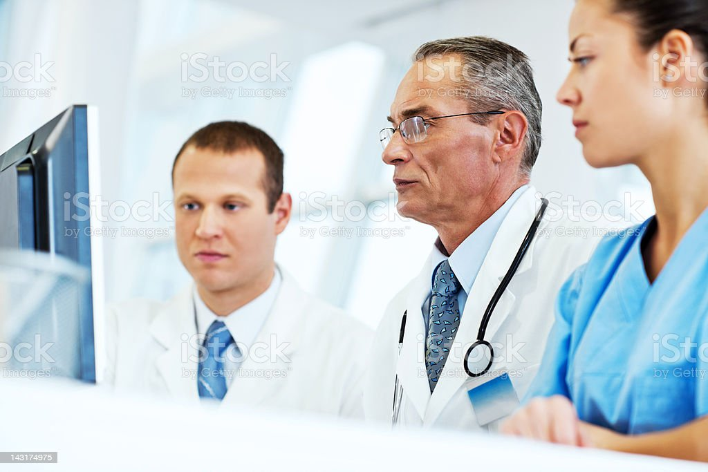 Group of a doctors checking Results royalty-free stock photo