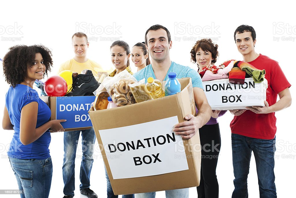 Group of a volunteers holding donation boxes. royalty-free stock photo