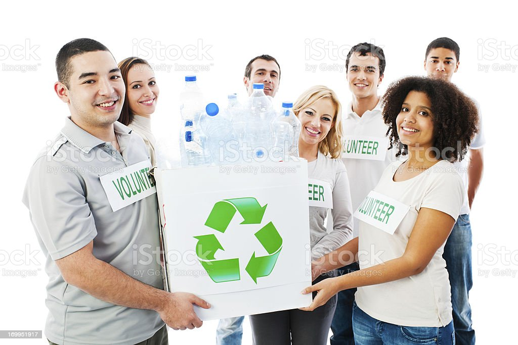 Group of a Volunteers holding recycling box full bottle. royalty-free stock photo