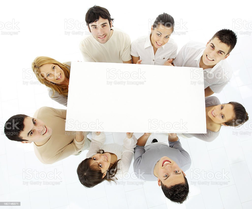Group of a young people looking up, holding blank boards. royalty-free stock photo