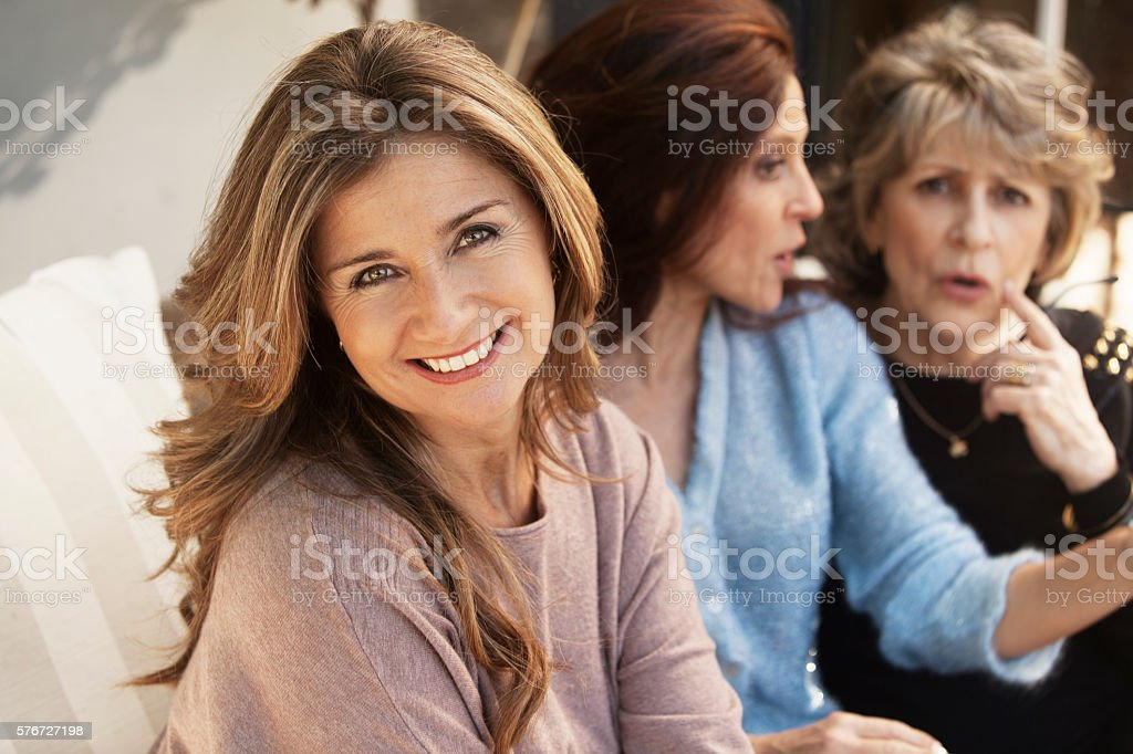 Group of adult and senior women talking stock photo