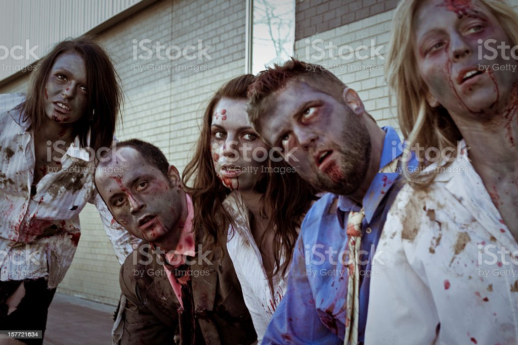 A group of adult zombies at a bus stop stock photo