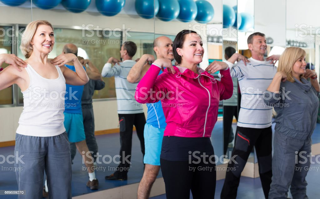 Group of adults doing aerobics exercise in  sport club stock photo