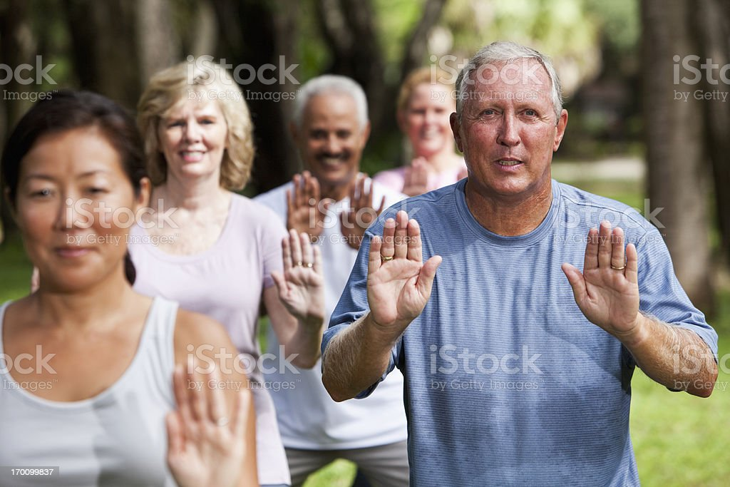 Group of adults exercising in park royalty-free stock photo