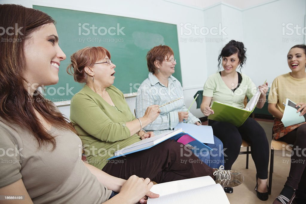 Group of Adults in Circle Having Discussion royalty-free stock photo