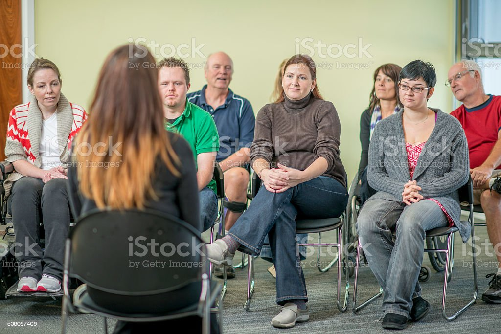Group of Adults Participating in a Therapy Session stock photo